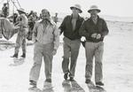 Brigadier General Jimmy Doolittle walks with WWI fighter Ace Eddie Rickenbacker and author Ernest Hemmingway during a tour of North African bases, this time visiting the 414th Bombardment Squadron in Tunisia, 1943