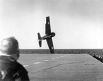 An FM-2 Wildcat in trouble immediately after take-off from USS Sable, Great Lakes, USA, May-June 1943.