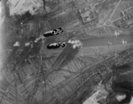Bomb bay view of Martin B-26 Marauder bombers of the 323rd and 394th Bomb Groups drop 122 tons of bombs in an effort to take down the railroad bridge across the Moselle river at Trier, Germany, 24 Dec 1944.