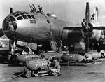 Ground crews arming a B-29 Superfortress of the 500th Bomb Group at Isley Field, Saipan, Mariana Islands, 1944-45.