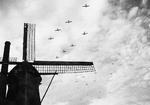 C-47 Skytrains towing Waco CG-4 gliders over Bergeijk, Holland en route the Operation Market Garden landings near Eindhoven, 17 Sep 1944.