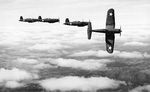 Four F4U Corsair fighters practicing aerial maneuvers, Mar-May 1943; probably stateside training.