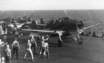 F6F Hellcat fighters going through launch procedures aboard the carrier Saratoga, off Gilbert Islands, early 1943.