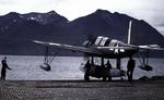 OS2U Kingfisher on a seaplane ramp in the Aleutians, Territory of Alaska, 1943-45. Note unusual National Insignia on upper right wing and Marsden matting on the ramp.