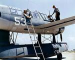 OS2U Kingfisher being tended to at a seaplane base, 1942-43; location unknown.