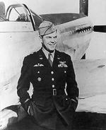 LtCol Bill Dunn in front of a P-51 Mustang. Dunn was the USA's first fighter ace flying with the RAF Eagle Squadron before USA entered the war. Note his USAAF wings, RAF brevet, & what may be a Luftwaffe Pilot badge.