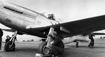 Navy Lt Bob Elder in a P-51D Mustang modified with a tailhook aboard the carrier Shangra-La for testing, 15 Nov 1944.
