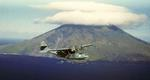 PBY-5A Catalina patrol plane flying past Segula Island (just east of Kiska), Aleutians, Summer 1942.