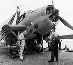 TBM-1 Avenger on a carrier deck, 1942-44. Note Mark XIII torpedo and crewman on top of the airplane handling an antenna from the ASB radar system.
