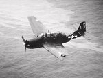 TBM-3 Avenger of VT-82 flying from the carrier Bennington struggles to remain airborne after receiving heavy damage in a mid-air collision with another Avenger over Chi Chi Jima, 18 Feb 1945.