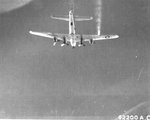B-17G Fortress of the 15th Air Force flies with No. 4 engine feathered and right wing smoking on a mission to Zwölfaxing, Austria, Jul 8 1944