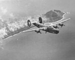 "B-24J Liberator ""Deadeye II"" of the 392nd Bomb Squadron flown by Lt. Warren Myllenbeck flying from Saipan, Mariana Islands, overflying Iwo Jima and Mt Suribachi, 1944-45."