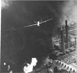 "B-24D Liberator ""The Sandman"" of the 345th Bomb Squadron over the burning Astra Romania oil refinery in Ploesti, Romania during Operation Tidal Wave, Aug 1 1943."