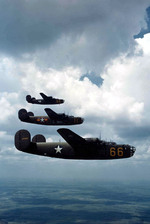 B-24D Liberators in formation, early 1943. This was probably a flight to test the visibility of a new National Insignia design.