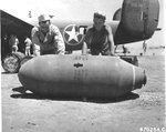 "USAAF Ordinancemen with the 514th Bomb Squadron preparing bombs at Soluch Airfield, Benghazi, Libya, mid-1943. B-24D Liberator ""Wash's Tub"" in the background was one of the bombers on the Ploesti Raid of Aug 1 1943."