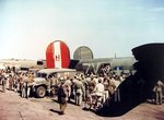 "Wounded aircrewmen are helped off B-24H Liberator ""Liberty Lib"" of the 752nd Bomb Squadron at RAF Horsham St Faith, Norfolk, England, UK after a raid on the Dornier factory at Lubeck, Germany, Aug 25 1944. Note the WC54 Ambulance."