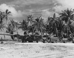 "B-24J Liberator ""Our Baby"" of the 27th Bomb Squadron at Funafuti Airfield, Gilbert Islands, Dec 1943."