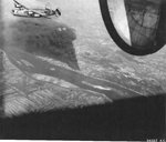 B-24J Liberator of the 856th Bomb Squadron over the target of the Rhenania-Ossag oil refinery near Hamburg, Germany, Aug 6 1944.