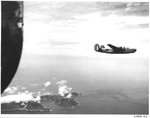 B-24J Liberator of the 431st Bomb Squadron flying over the island of Haha Jima, Japan, 1944.
