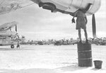 B-24J Liberators of the 494th Bomb Group receive maintenance on Angaur, Palau Islands, Dec 8 1944