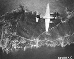 B-26B Marauder of the 441st Bomb Squadron over Île du Levant, France south of St Tropez on raid to bomb gun installations, Aug 4 1944