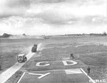 "B-26C Marauder ""Carefree Carolyn"" of the 552nd Bomb Squadron makes a wheels-up landing after having her hydraulics shot out, RAF Great Dunmow, Essex, England, June 15 1944. Note the WC54 Ambulance and fire crews rushing to the scene. Photo 1 of 2"