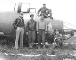 "Crew of B-26C Marauder ""Carefree Carolyn"" of the 552nd Bomb Squadron in front of their airplane after making a wheels-up landing, RAF Great Dunmow, Essex, England, June 15 1944. This was the aircraft's 100th mission. Photo 2 of 2"