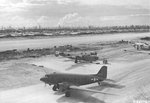 The airstrip at Angaur, Palau Islands Dec 9 1944 with B-24Js of the 22nd Bomb Group on the near side and B-24s of the 494th Bomb Group on the far side; plus one C-47A Skytrain supply aircraft.