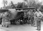 "L-5 Sentinel ""Bouncing Betsy II"" of the 25th Liaison Squadron in New Guinea. Sgt pilots of the ""Guinea Short Line"" rescued downed fliers and guided fighters to concealed jungle targets. SSGT Jim Nichols standing by the pilot's door"