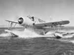 OS2U-2 Kingfisher scout plane plows through the water, 1941