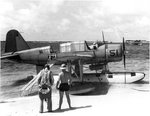 OS2U Kingfisher at the edge of the seaplane ramp at NAS Pensacola, Florida, United States, early 1941. Note Consolidated P2Y flying boat laying off shore, photo 1 of 2 (b/w)