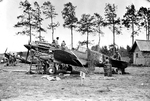 P-40C Tomahawk IIA with the AVG Flying Tigers receiving needed maintenance alongside a Ryan PT-22 Recruit trainer at Kunming, China, Nov 1941-Spring 1942