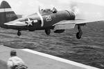"USAAF pilot Lt Eubanks Barnhill flies his P-47D Thunderbolt off the deck of Escort Carrier USS Manila Bay to ward off an aerial attack from four D3A Aichi ""Val"" dive bombers during refueling operations east of Saipan, Jun 23 1944. Photo 2 of 2"