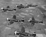 Element of the 62nd Fighter Squadron fly their P-47 Thunderbolts over the English countryside, Apr-Jun 1943; these fighters were based at RAF Horsham St Faith, Norfolk, England, UK.