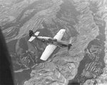 P-51C Mustang of the 311th Fighter Group escorting C-47 Skytrain transports over a terraced landscape in China, July 24 1945