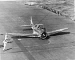 SBD-5 Dauntless making a belly landing on USS Yorktown (Essex-class) after a combat strike, Sep 1943 - May 1944