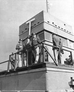 The 4th Fighter Group's control tower at RAF Debden, Essex, England, UK, Sep 25 1943. Front to Back: BGen Frederick L Anderson, Jr; Mr Donald Nelson, Chief of US War Production; LCol Chesley Peterson, 4th Fighter Group Commanding Officer.