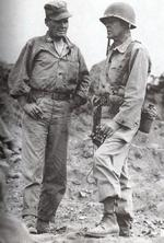 US Marine Colonel Chesty Puller (left) speaks with Assistant Division Commander Brigadier General Edward Craig overlooking Seoul, South Korea, 25 Sep 1950, photo 1 of 2