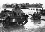 Allied Forces come ashore during the invasion of Sicily, July 1943.  Note the Universal Carrier.