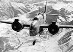 A Model 187 Baltimore light bomber of Royal Air Force 223 Squadron flying from Celone, Italy drops bombs on the railway junction at Sulmona, a strategic point on the east-west route across Italy, in February of 1944