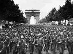 US Twenty-Eighth Infantry Division march along the Champs-Élysées, Paris, France with l'Arc de Triomphe in the background, Aug 29 1944. Photo 2 of 2.