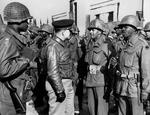 Lt General Lucian Truscott, commanding general of the US Fifth Army in Italy, inspects African-American troops of the 92nd Infantry Division after they threw back a German attack in the hills north of Viareggio, Italy in 1944.