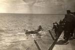 A TBM Avenger after a water landing beside the training aircraft carrier USS Sable on Lake Michigan, United States, 1944-45. Photo 1 of 2.