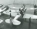 SNJ-3 Texan training aircraft tied to the flight deck aboard the training aircraft carrier USS Wolverine on Lake Michigan, United States, 1942.