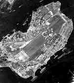 Ford Island Naval Air Station, Pearl Harbor, Hawaii during the build-up before the Leyte Gulf landings with over 1,000 aircraft visible on the islands with more arriving on transport carriers, Sep 5, 1944.