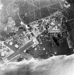 The Ewa Plain on the south coast of Oahu, Hawaii with Barbers Point Naval Air Station on the left and the former Ewa Marine Corps Air Station on the right, Nov 20, 1959
