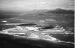Crossed runways of Barbers Point Naval Air Station on the Ewa Plain, Oahu, Hawaii looking north with the Wai'anae Mountains in the background, Oct 1965