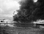 Battleship Arizona burning and settled on the bottom as seen from Ford Island, Pearl Harbor, Oahu, Hawaii, Dec 7, 1941.