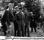 "Gen ""Hap"" Arnold, Gen Dwight Eisenhower, Adm Ernest King (white cap behind Eisenhower), and Gen George Marshall visit the guns moved from Pointe du Hoc, Normandy, France, Jun 12, 1944."