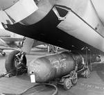 A Mark XIII torpedo being prepared for loading into the bomb bay of a TBM-1C Avenger for a raid against Tarawa, Gilbert Islands, Nov 1943.